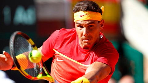 FILE - In this Sunday April 8, 2018 file photo, Spain's Rafael Nadal returns the ball to Germany's Alexander Zverev during a World Group quarterfinal Davis Cup tennis match between Spain and Germany at the bullring in Valencia, Spain. Rafael Nadal is wary of saying hes fully recovered from a troublesome right thigh injury as he defends his Monte Carlo Masters title. The top-ranked Spaniard only recently returned to action at the Davis Cup, after a recurrence of the injury forced him out of the Mexico Open and then Masters tournaments at Indian Wells and Miami last month. (AP Photo/Alberto Saiz, File)