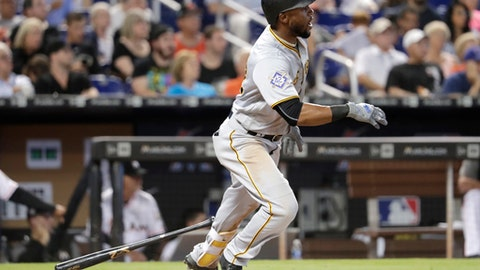 Pittsburgh Pirates' Starling Marte begins to run after hitting a single during the fifth inning of a baseball game against the Miami Marlins, Sunday, April 15, 2018, in Miami. (AP Photo/Lynne Sladky)