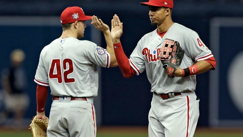 Philadelphia Phillies right fielder Aaron Altherr, right, high-fives second baseman Scott Kingery after they defeated the Tampa Bay Rays in a baseball game Sunday, April 15, 2018, in St. Petersburg, Fla. (AP Photo/Chris O'Meara)
