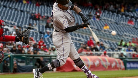 Colorado Rockies' Ian Desmond hits a home run to put the Rockies ahead in the ninth inning against the Washington Nationals at Nationals Park Sunday, April 15, 2018, in Washington. The Rockies won 6-5. (AP Photo/Andrew Harnik)