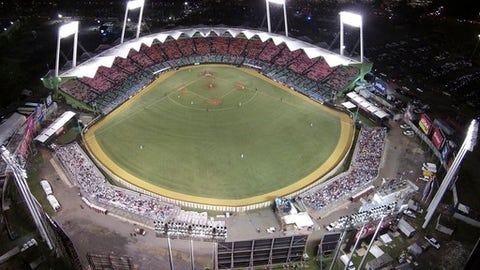 FILE - In this Feb. 6, 2015, file photo, Puerto Rico plays Dominican Republic at the Caribbean Series baseball tournament at Hiram Bithorn Stadium in San Juan, Puerto Rico. The Cleveland Indians and Minnesota Twins play baseball in San Juan on April 17-18. (AP Photo/Ricardo Arduengo, File)