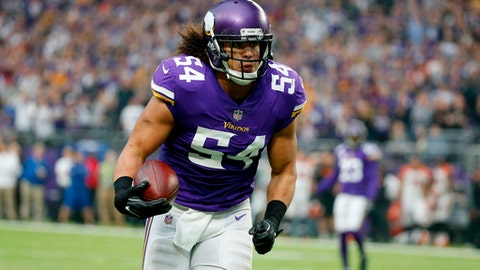 FILE - In this Dec. 17, 2017, file photo, Minnesota Vikings middle linebacker Eric Kendricks returns an interception for a touchdown during the first half of an NFL football game against the Cincinnati Bengals, Minneapolis. The Vikings have signed linebacker Eric Kendricks to a contract extension. The Vikings announced the deal Monday, April 16, 2018, the first day of offseason workouts. (AP Photo/Bruce Kluckhohn, File)