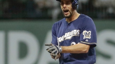 Milwaukee Brewers' Jorge Lopez reacts after hitting a two-run scoring double during the seventh inning of a baseball game Monday, April 16, 2018, in Milwaukee. (AP Photo/Morry Gash)