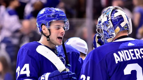 Toronto Maple Leafs centre Auston Matthews (34) and goaltender Frederik Andersen (31) celebrate after defeating the Boston Bruins in NHL round one playoff hockey action in Toronto on Monday, April 16, 2018. (Frank Gunn/The Canadian Press via AP)
