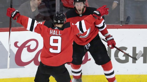 New Jersey Devils right wing Stefan Noesen, right, celebrates his goal against the Tampa Bay Lightning with teammate Taylor Hall (9) during the third period of Game 3 of an NHL first-round hockey playoff series, Monday, April 16, 2018, in Newark, N.J. The Devils won 5-2. (AP Photo/Julio Cortez)