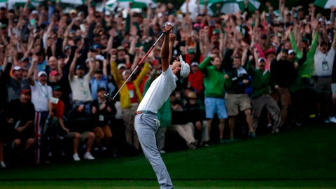 FILE - In this April 14, 2013, file photo, Adam Scott, of Australia, celebrates after making a birdie putt on the second playoff hole to win the Masters golf tournament in Augusta, Ga. This was Rory McIlroy's favorite major memory that wasn't his own. (AP Photo/David J. Phillip, File)