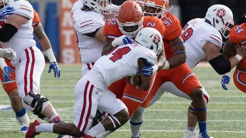 """<p>(STATS) - That former Sam Houston State quarterback Jeremiah Briscoe has won the STATS FCS Walter Payton Award for two straight seasons underscores the Southland Conference's reputation as an offensive conference.</p><p>But the prospects for next week's NFL draft indicate defensive and special teams talent are particularly in demand this year.</p><p>Sam Houston State defensive tackle P.J. Hall has been one of the bigger risers on draft boards in the last month after testing well at his pro day. The 6-foot, 308-pounder has impressive speed for his size - 4.74 seconds in the 40-yard dash - and power - 36 reps on the 225-pound bench press - with the versatility to be moved across the line. He generally played defensive end with the Bearkats, cranking out an FCS-career record 86 1/2 tackles for loss as well as 42 sacks and 14 blocked kicks.</p><p>""""He is so explosive and does not get fooled by what blockers are doing,"""" said Hall's college defensive line coach Rod Wright, who played four seasons in the NFL. """"He recognizes blocks well, and is going to be a tough for anyone whether he is playing inside or outside.""""</p><p>Earlier in evaluations for the April 26-28 draft, Franklin rose after impressing at the NFLPA Collegiate Bowl and the NFL combine. The 6-4, 283-pounder, who has an 82-inch wingspan, was clocked at 4.75 seconds in the 40 with 26 reps on the bench press at the combine.</p><p>Like Hall and Franklin, Central Arkansas cornerback Tremon Smith, one of the fastest candidates at the position, and Southeastern Louisiana defensive end Sione Teuhema will be considered for day three of the draft.</p><p>Incarnate Word's Joe Zema also is considered the top punter prospect coming out of the FCS. Punters aren't drafted often, but two years ago Sam Houston State's Lachlan Edwards was a seventh-round pick of the New York Jets.</p><p>Hall, Smith, Teuhema and Zema made the 2017 STATS FCS All-America first team after their senior seasons.</p>"""