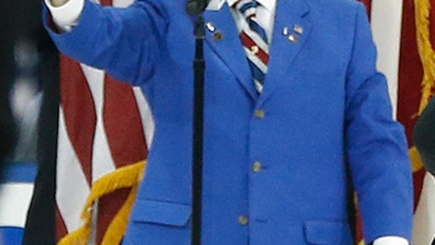 FILE - In this June 9, 2014, file photo, John Amirante sings the national anthem before Game 3 of the NHL hockey Stanley Cup Finals between the Los Angeles Kings and New York Rangers, in New York. Longtime New York Rangers anthem singer John Amirante has died. He was 83. Amirantes wife, Annie, told Rangers vice president of event presentation he died of natural causes on Tuesday morning, April 17, 2018, in New York after being hospitalized for about a week. (AP Photo/Kathy Willens, File)