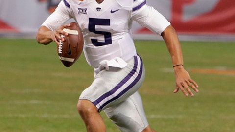 FILE - In this Dec. 26, 2017, file photo, Kansas State quarterback Alex Delton (5) plays in the second half during an NCAA college football bowl game against UCLA, in Phoenix. Kansas State returns 14 starters from a team that won eight games and beat UCLA in the Cactus Bowl, including its top quarterback and the entire offensive line, so it stands to reason that few jobs would be available in spring camp. Thats hardly the case. Especially at quarterback. (AP Photo/Rick Scuteri, File)