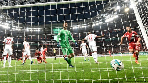 Bayern goalkeeper Sven Ulreich, center, receives a goal by Leverkusen's Lars Bender during the German soccer cup semifinal match between Bayer Leverkusen and Bayern Munich in Leverkusen, Germany, Tuesday, April 17, 2018. (AP Photo/Martin Meissner)