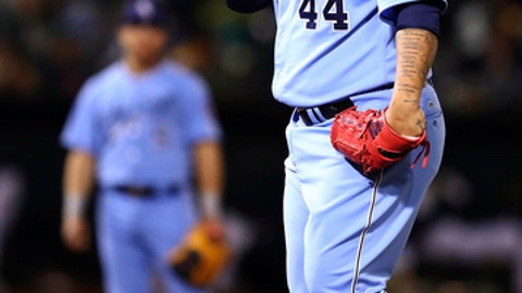 Chicago White Sox pitcher Bruce Rondon wipes his face during the seventh inning of the team's baseball game against the Oakland Athletics on Tuesday, April 17, 2018, in Oakland, Calif. (AP Photo/Ben Margot)