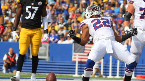 FILE - In this Aug. 29, 2015, file photo, Buffalo Bills running back Fred Jackson (22) celebrates his touchdown in front of Pittsburgh Steelers inside linebacker Terence Garvin (57) during the first half of a preseason NFL football game, in Orchard Park, N.Y. Running back Fred Jackson is signing a one-day contract with the Buffalo Bills on Wednesday, April 18, 2018, to officially retire with his former team.(AP Photo/Bill Wippert, File)
