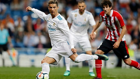 Real Madrid's Cristiano Ronaldo shoots the ball during a Spanish La Liga soccer match between Real Madrid and Athletic Bilbao at the Santiago Bernabeu stadium in Madrid, Wednesday, April 18, 2018. (AP Photo/Francisco Seco)
