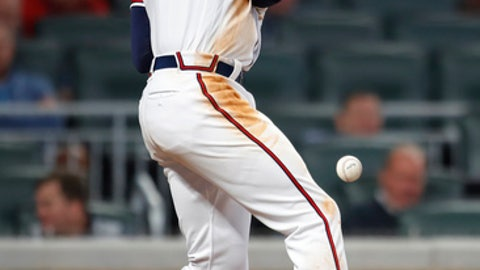 Atlanta Braves' Freddie Freeman is hit by a pitch in the eighth inning of the team's baseball game against the Philadelphia Phillies, Wednesday, April 18, 2018, in Atlanta. (AP Photo/Todd Kirkland)