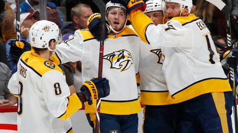Nashville Predators center Colton Sissons, second from left, celebrates scoring his goal with, from left, center Kyle Turris, defensemen Alexei Emelin and Mattias Ekholm, against the Colorado Avalanche during the second period of Game 4 of an NHL hockey first-round playoff series Wednesday, April 18, 2018, in Denver. (AP Photo/David Zalubowski)