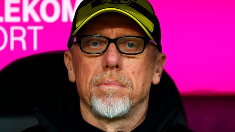 FILE - In this March 31, 2018 file photo, Dortmund coach Peter Stoeger sits on the bench prior to the German Bundesliga soccer match between FC Bayern Munich and Borussia Dortmund in Munich, Germany. Borussia Dortmund coach Peter Stoeger is yet to show that he is the man to oversee the sides revitalization after another difficult season for the club. (AP Photo/Matthias Schrader,file)