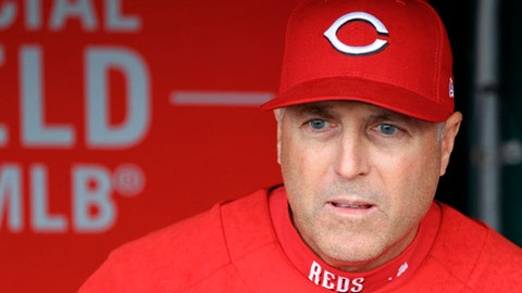 FILE - In this April 14, 2018, file photo, Cincinnati Reds' manager Bryan Price stands in the dugout prior to a baseball game against the St. Louis Cardinals, in Cincinnati. The Reds have fired Bryan Price after a 3-15 start, the first managerial change in the major leagues this season. Price was in his fifth season leading the rebuilding team. The Reds have lost at least 94 games in each of the last three seasons while finishing last in the NL Central. Bench coach Jim Riggleman will manage the team on an interim basis. (AP Photo/Aaron Doster, File)