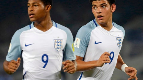 FILE - In this Wednesday, Oct. 25, 2017 file photo, England's Morgan Gibbs White, right, and Rhian Brewster follow the ball during the FIFA U-17 World Cup semifinal match against Brazil in Kolkata, India. FIFA on Thursday, April 19, 2018 has closed a racism investigation that involved a Spain player and an England opponent from the Under-17 World Cup final. FIFA says its disciplinary panel dismissed the charge against the Spanish player because of a lack of sufficient evidence that could corroborate the English players claim. England striker Rhian Brewster reported overhearing teammate Morgan Gibbs-White being called a monkey during the teams 5-2 win over Spain in India last October. (AP Photo/Bikas Das, file)