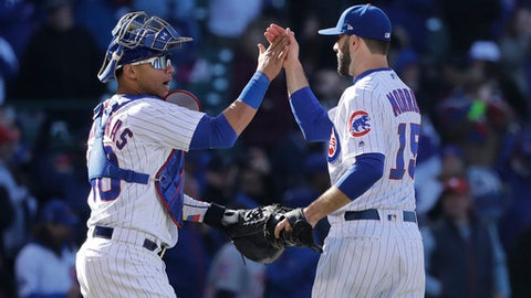 Chicago Cubs catcher Willson Contreras, left, and relief pitcher Brandon Morrow celebrate their win over the St. Louis Cardinals after a baseball game Thursday, April 19, 2018, in Chicago. (AP Photo/Charles Rex Arbogast)