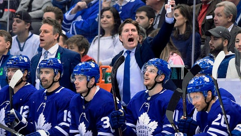Toronto Maple Leafs coach Mike Babcock reacts during the third period of Game 4 of an NHL hockey first-round playoff series against the Boston Bruins on Thursday, April 19, 2018, in Toronto. (Nathan Denette/The Canadian Press via AP)
