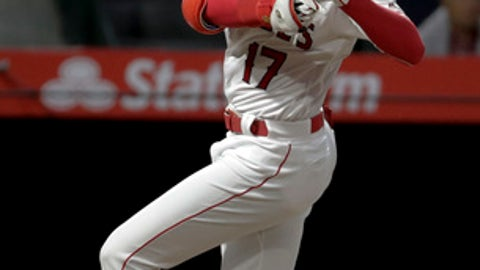 Los Angeles Angels' Shohei Ohtani gets out of the way of a high pitch during the second inning of a baseball game against the San Francisco Giants in Anaheim, Calif., Friday, April 20, 2018. (AP Photo/Chris Carlson)