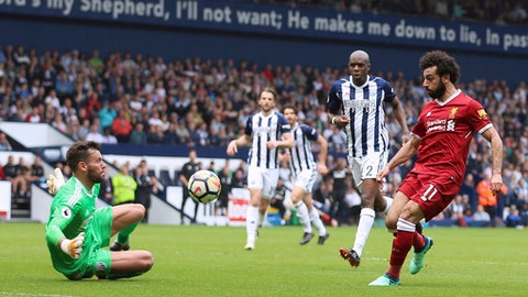 Liverpool's Mohamed Salah scores his side's second goal of the game, during the English Premier League soccer match between West Bromwich Albion and Liverpool, at The Hawthorns, West Bromwich, England, Saturday April 21, 2018. (Nigel French/PA via AP)