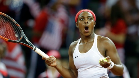Sloane Stephens of USA celebrates after defeating Pauline Parmentier of France during the Fed Cup semifinal singles tennis match in Aix-en-Provence, southern France, Saturday, April 21, 2018. (AP Photo/Claude Paris)