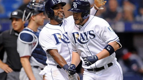 Tampa Bay Rays' Denard Span, center, congratulates C.J. Cron, right, after scoring on Cron's two-run home run off Minnesota Twins reliever Gabriel Moya during the seventh inning of a baseball game Saturday, April 21, 2018, in St. Petersburg, Fla. (AP Photo/Steve Nesius)