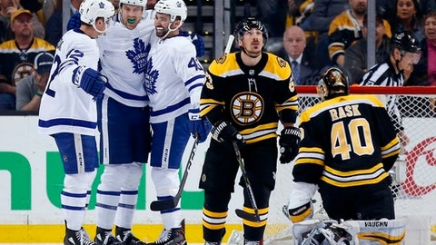 Toronto Maple Leafs' James van Riemsdyk (25) celebrates his goal against Boston Bruins' Tuukka Rask (40), of Finland, with teammates Tyler Bozak (42) and Nazem Kadri (43) during the second period of Game 5 of an NHL hockey first-round playoff series in Boston, Saturday, April 21, 2018. (AP Photo/Michael Dwyer)