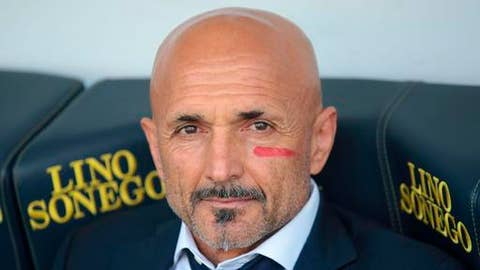 Inter Milan coach Luciano Spalletti sports a red sign on his face as part of an initiative aimed at raising public awareness of violence against women, prior to the Serie A soccer match between Inter and Chievo Verona, at the Bentegodi stadium in Verona, Italy, Sunday, April 22, 20018. (Filippo Venezia/ANSA via AP)