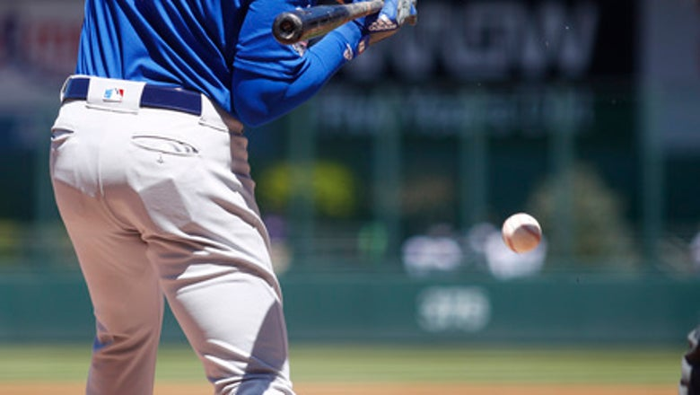Cubs' Kris Bryant hit on helmet by pitch, leaves game