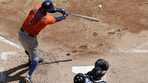Houston Astros' Carlos Correa hits a single against the Chicago White Sox during the third inning of a baseball game Sunday, April 22, 2018, in Chicago. The Astros won 7-1. (AP Photo/Nam Y. Huh)
