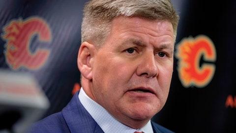 New Calgary Flames NHL hockey team head coach Bill Peters speaks to the media in Calgary, Alberta, Monday, April 23, 2018. (Jeff McIntosh/The Canadian Press via AP)
