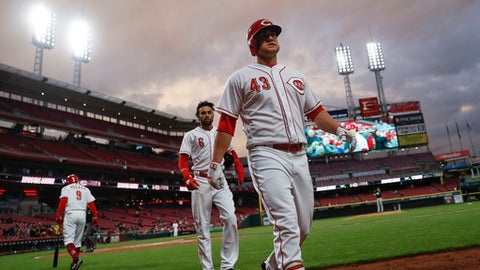 Cincinnati Reds' Scott Schebler (43) walks back to the dugout after hitting a two-run home run off Atlanta Braves starting pitcher Mike Foltynewicz in the fifth inning of a baseball game, Monday, April 23, 2018, in Cincinnati. (AP Photo/John Minchillo)