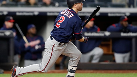 Minnesota Twins' Brian Dozier (2) hits a fifth-inning, RBI single in a baseball game against the New York Yankees in New York, Monday, April 23, 2018. (AP Photo/Kathy Willens)