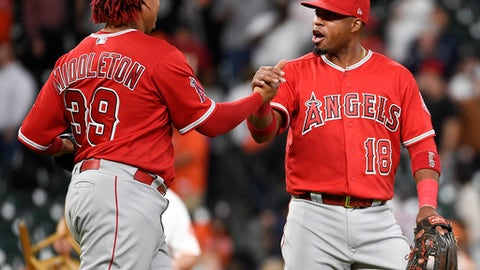 Los Angeles Angels' Luis Valbuena, right, and Keynan Middleton celebrate the team's win in a baseball game against the Houston Astros, Monday, April 23, 2018, in Houston. (AP Photo/Eric Christian Smith)