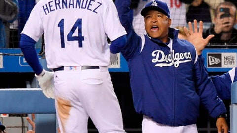 Los Angeles Dodgers' Enrique Hernandez, left, is congratulated by manager Dave Roberts after hitting a solo home run during the fourth inning of a baseball game against the Miami Marlins Monday, April 23, 2018, in Los Angeles. (AP Photo/Mark J. Terrill)