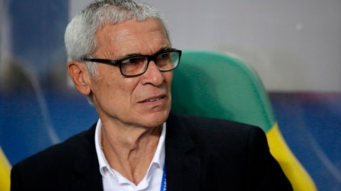 FILE - In this Sunday, Feb. 5, 2017 file photo, Egypt coach Hector Cuper, from Argentina, sits on the bench during the African Cup of Nations final soccer match between Egypt and Cameroon at the Stade de l'Amitie, in Libreville, Gabon. (AP Photo/Sunday Alamba, File)
