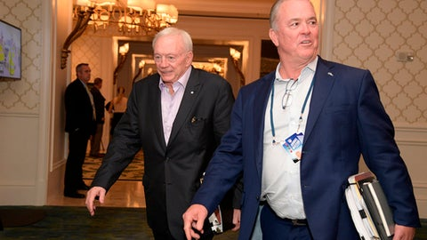 FILE - In this March 28, 2018, file photo, Dallas Cowboys owner Jerry Jones, left, and director of player personnel Stephen Jones leave a conference room during the NFL owners meetings in Orlando, Fla. With Dez Bryant gone, the Dallas Cowboys have to decide if they will use their top pick on a receiver for the first time since taking him eight years ago.  The answer on going that high to get another target for quarterback Dak Prescott, as it was before Bryants release this month, is an emphatic maybe. (Phelan M. Ebenhack/AP Images for NFL, File)