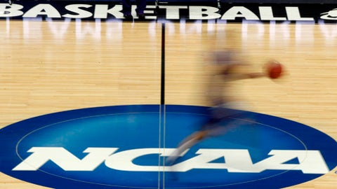 "FILE - In this March 14, 2012, file photo, a player runs across the NCAA logo during practice in Pittsburgh before an NCAA tournament college basketball game. College basketball spent an entire season operating amid a federal corruption investigation that magnified long-simmering problems within the sport, from unethical agent conduct to concerns over the ""one-and-done"" model. Now its time to hear new ideas on how to fix them. On Wednesday morning, April 25, 2018, the commission headed by former Secretary of State Condoleezza Rice will present its proposed reforms to university presidents of the NCAA Board of Governors and the Division I Board of Directors at the NCAA headquarters in Indianapolis. And that starts what could be a complicated process in getting changes adopted and implemented in time for next season. (AP Photo/Keith Srakocic, File)"