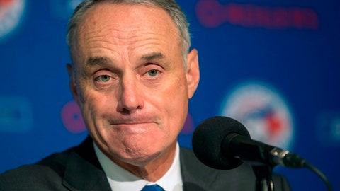 Baseball Commissioner Rob Manfred takes questions from the media before a game between the Boston Red Sox and the Toronto Blue Jays in Toronto on Tuesday, April 24, 2018. (Fred Thornhill/The Canadian Press via AP)