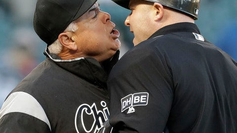 Chicago White Sox manager Rick Renteria, left, argues with home plate umpire Mike Estabrook after Estabrook called Matt Davidson out on strikes to end the sixth inning of a baseball game against the Seattle Mariners Tuesday, April 24, 2018, in Chicago. (AP Photo/Charles Rex Arbogast)