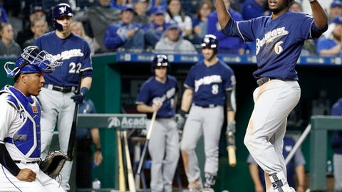 Milwaukee Brewers' Lorenzo Cain (6) celebrates as the crosses the plate after hitting a solo home run during the seventh inning of a baseball game against the Kansas City Royals Tuesday, April 24, 2018, in Kansas City, Mo. (AP Photo/Charlie Riedel)