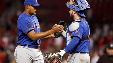 New York Mets relief pitcher Jeurys Familia, left, and catcher Tomas Nido celebrate following the team's 6-5 win in 10 innings in a baseball game against the St. Louis Cardinals on Tuesday, April 24, 2018, in St. Louis. (AP Photo/Jeff Roberson)