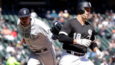 Seattle Mariners starting pitcher Felix Hernandez, left, tags out Chicago White Sox designated hitter Daniel Palka during the third inning of a baseball game Wednesday, April 25, 2018, in Chicago. Yolmer Sanchez scored on the play. (AP Photo/Charles Rex Arbogast)