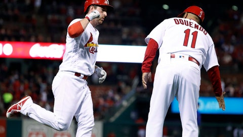 St. Louis Cardinals' Jedd Gyorko, left, is congratulated by third base coach Jose Oquendo after hitting a solo home run during the fifth inning of a baseball game against the New York Mets on Wednesday, April 25, 2018, in St. Louis. (AP Photo/Jeff Roberson)