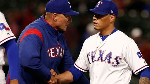 Texas Rangers pitcher Keone Kela (50) is congratulated by manager Jeff Banister after picking up the save as the Rangers defeated the Oakland Athletics 4-2 in a baseball game Wednesday, April 25, 2018, in Arlington, Texas. (AP Photo/Mike Stone)