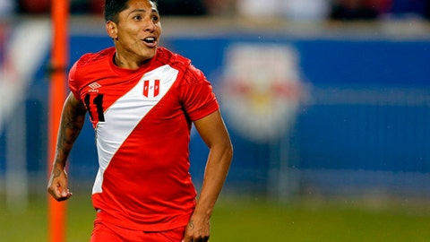 In this photo taken on Tuesday, March 27, 2018 Peru forward Raul Ruidiaz (11) celebrates scoring a goal against Iceland during the second half of an international friendly soccer match Tuesday, March 27, 2018, in Harrison, N.J. (AP Photo/Adam Hunger)