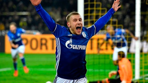 FILE - In this Nov. 25, 2017 file photo Schalke's Max Meyer celebrates after Naldo scored Schalke's 4th goal during the German Bundesliga soccer match between Borussia Dortmund and FC Schalke 04 in Dortmund, Germany. Schalke attacking midfielder Max Meyer will become the latest player to leave the club on a free transfer at the end of the season after failing to reach agreement over a contract extension. Schalke sporting director Christian Heidel says Thursday, April 26, 2018 , Were dealing with the situation very professionally. (AP Photo/Martin Meissner,file)