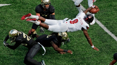 FILE - In this Oct. 28, 2017, file photo, Louisville's Lamar Jackson (8) is upended by Wake Forest's Coby Davis (20) during the second half of an NCAA college football game in Winston-Salem, N.C. Jackson is expected to be taken in the NFL Draft.(AP Photo/Chuck Burton, File)
